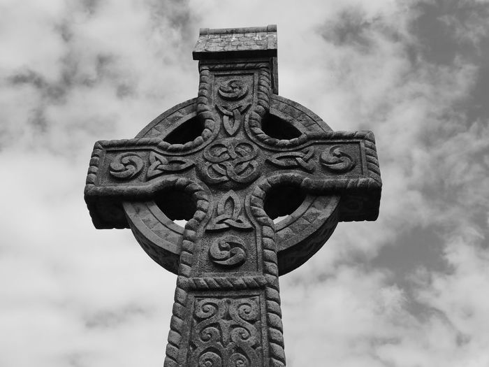 Low Angle View Of Cross On Cemetery Against Sky