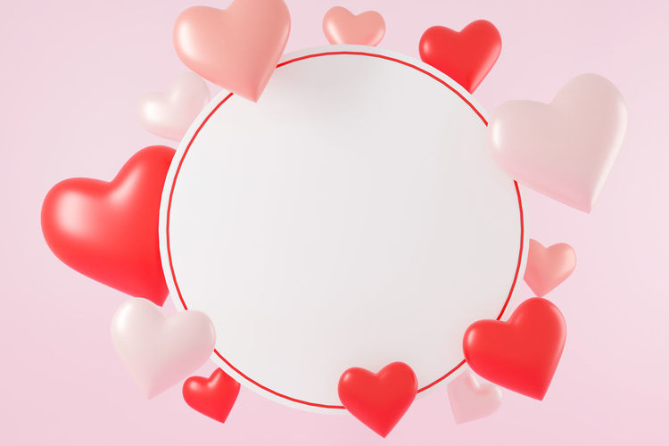 Directly above shot of heart shape against red background