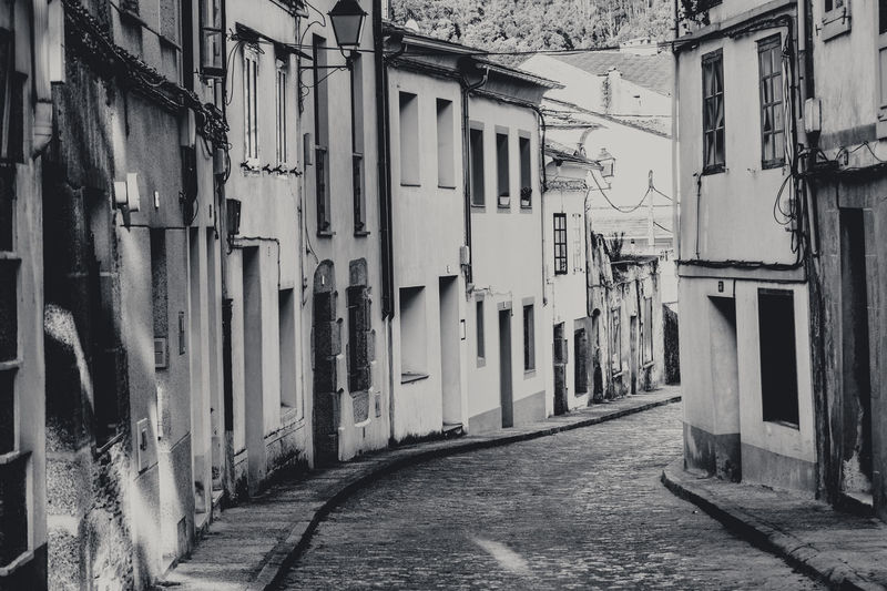 Alley Architecture Black And White Building Building Exterior Built Structure Day Diminishing Perspective Empty Galicia Long Monochrome Narrow No People Old House Outdoors Quiet Residential Building Residential District Residential Structure Street Town Vanishing Point Village Walkway