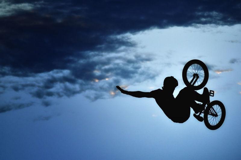 Low Angle View Of Man Riding Bike