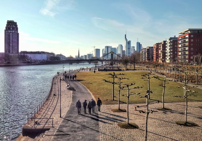 sonniger Winternachmittag - kalt! Walk Along The River Sunny Winterday Sunny But Freezing Walking Citizens Frankfurt Skyline Main-River Blue Sky City Life City Scape Frankfurt Am Main Germany🇩🇪 Skyscraper Architecture Building Exterior City Sky Urban Skyline Built Structure Water Day The Street Photographer - 2018 EyeEm Awards #urbanana: The Urban Playground