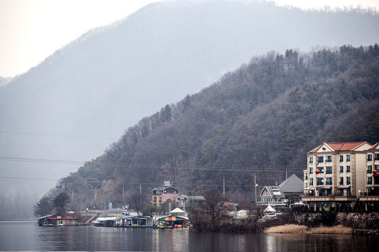 Bukhangang Community Countryside Day Development Distant Fog Hill Human Settlement Lake Landscape Mountain Mountain Range Nami Island Non-urban Scene Outdoors Remote Residential District River Riverscape Riverside Scenics Tranquil Scene Tranquility Winter