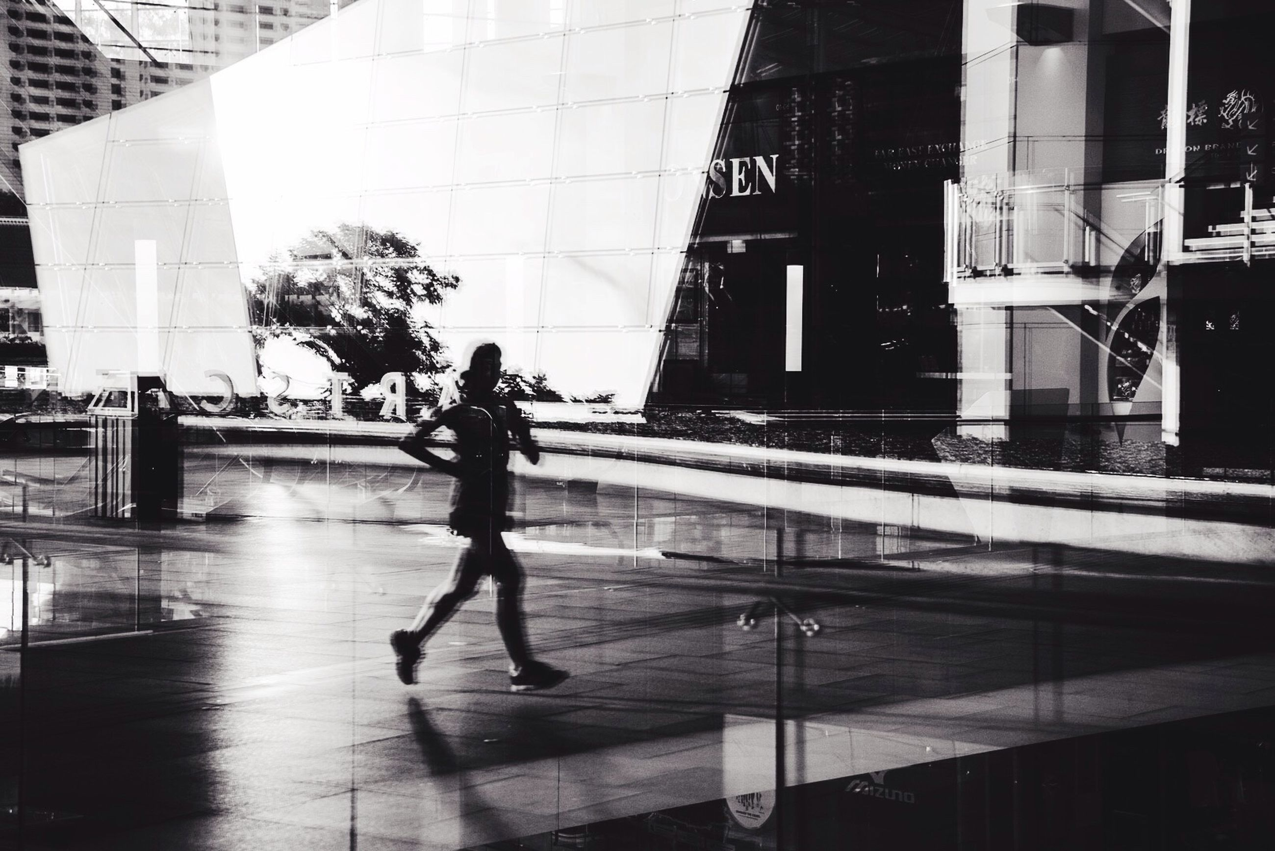 architecture, building exterior, built structure, city, full length, walking, lifestyles, men, city life, building, street, reflection, modern, person, leisure activity, on the move, shadow, transportation