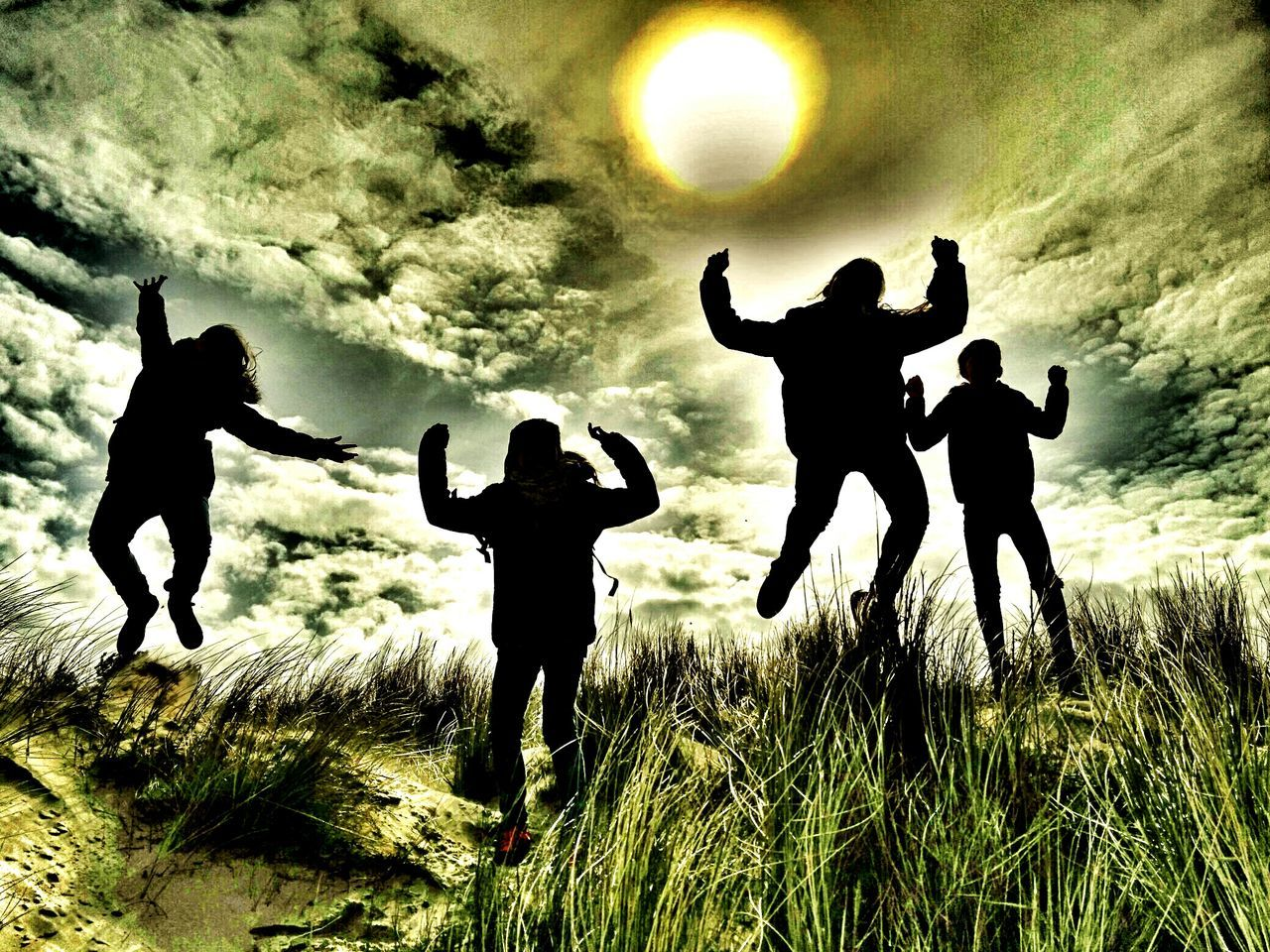 silhouette, arms raised, full length, men, arms outstretched, grass, standing, jumping, outdoors, togetherness, sunset, real people, nature, sky, day, people