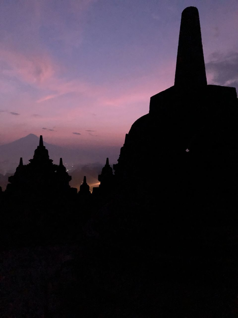 SILHOUETTE OF TEMPLE AGAINST SKY AT SUNSET