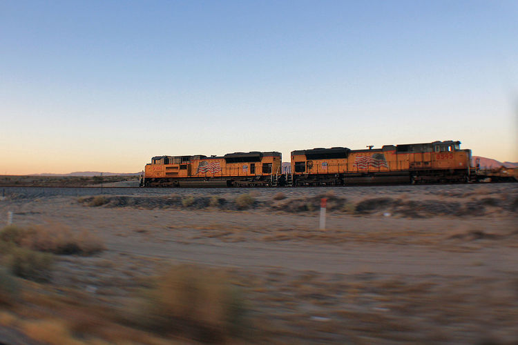 Railroad Track Salton Sea Architecture Beach Beauty In Nature Clear Sky Copy Space Day Freight Train Mode Of Transport Nature No People Outdoors Roadtrip Scenics Sea Sky Sunset Transportation Water