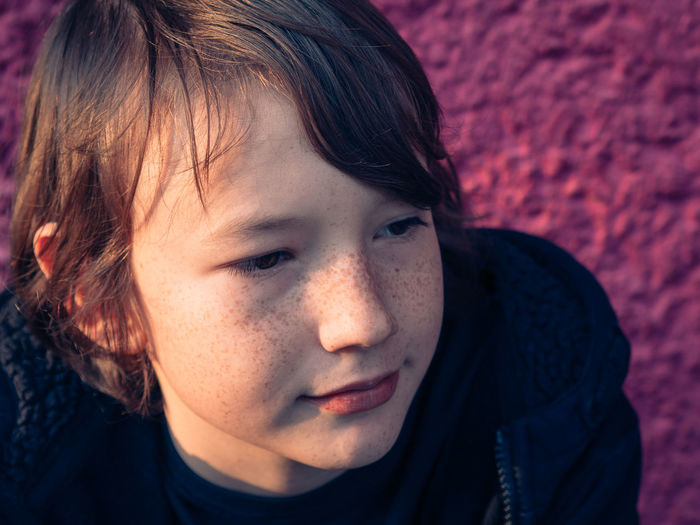 Portrai of a happy boy in the sunlight Background Boy Child Childhood Close-up Day Dreaming Freckles Happy Headshot Human Body Part Human Face Kid Millennial Pink One Boy Only One Person Outdoors People Pink Pink Color Portrait Real People Summertime Thoughtful Young Adult