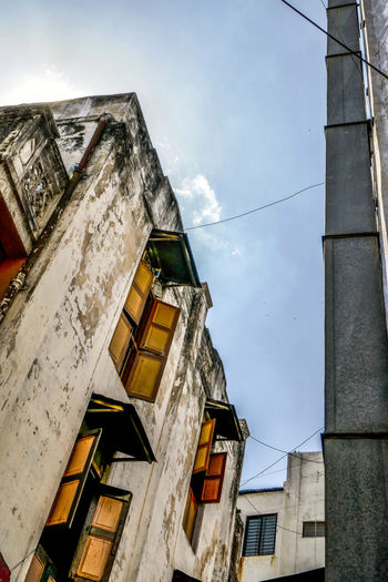 Low angle view of old buildings against sky
