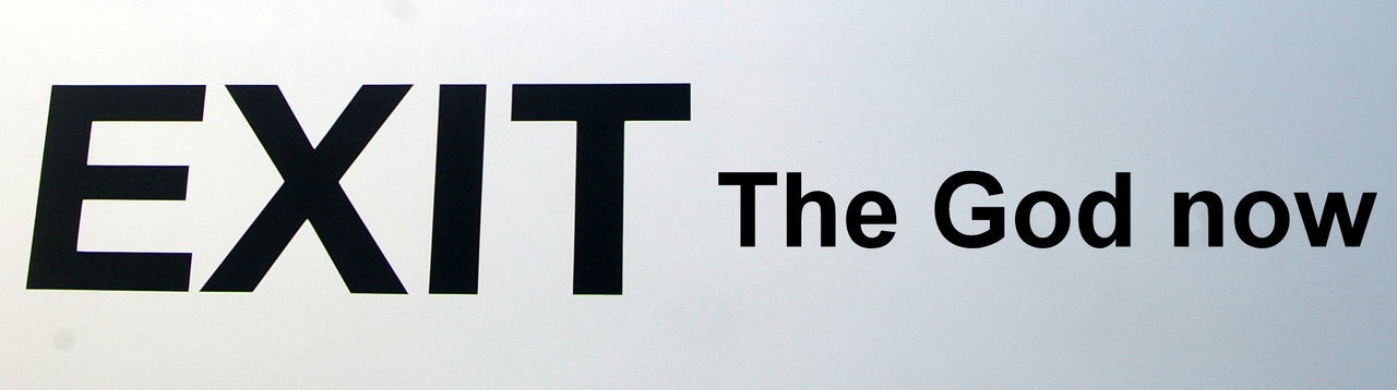 Panoramic Shot Of Exit Sign And Text Against White Background