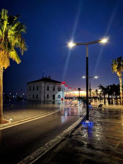 Night Illuminated Star - Space Sky Street Light Outdoors Water Building Exterior No People Clear Sky Tree Cityscape Astronomy Astrology Sign Nature Weather Storm Stormy Weather Slovenia Storms Adriatic Sea Storm Approaching Dramatic Sky Harbor Cloud - Sky