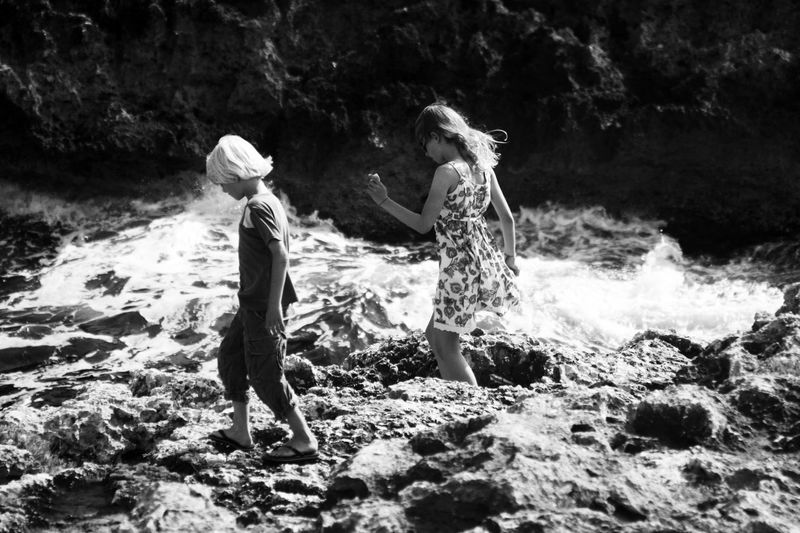 Kids Mallorca Rock Formation Rocky Cliffs Rocky Coastline Summertime Wave Beauty In Nature Blackandwhite Bonding Boy Childhood Cliff Fun Girl Leisure Activity Rocks And Water Seascape Togetherness Two People Walking Water Wind Young And Free Canon Be. Ready. Summer Exploratorium