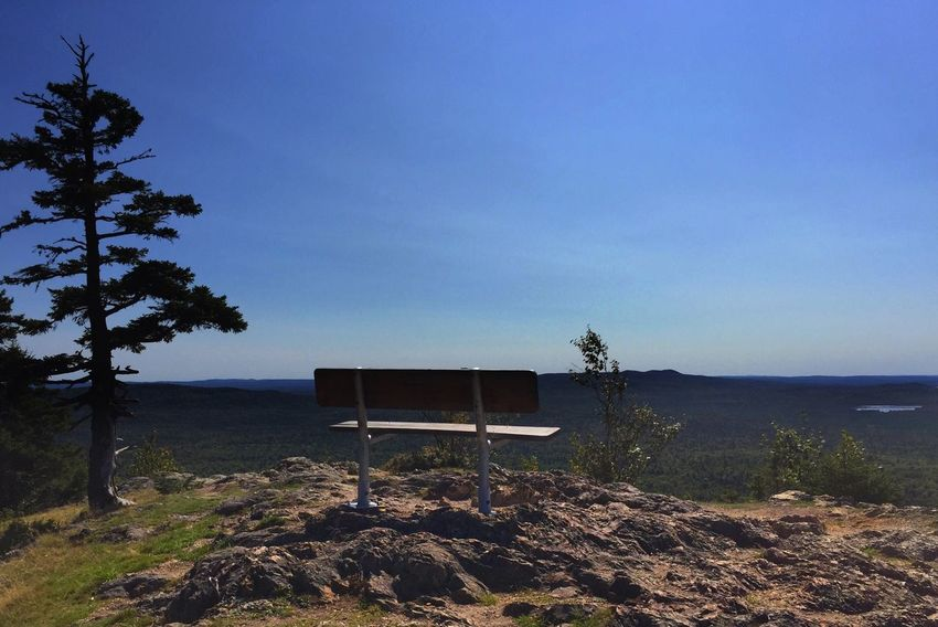 Front row seat to a Maine north woods vista. Haystack Mountain View From Haystack Mountain Vista Maine North Woods Bench Rest Relax Nature Tranquility Tree Scenics Beauty In Nature Outdoors Tranquil Scene Sky No People Built Structure Landscape Day Betterlandscapes