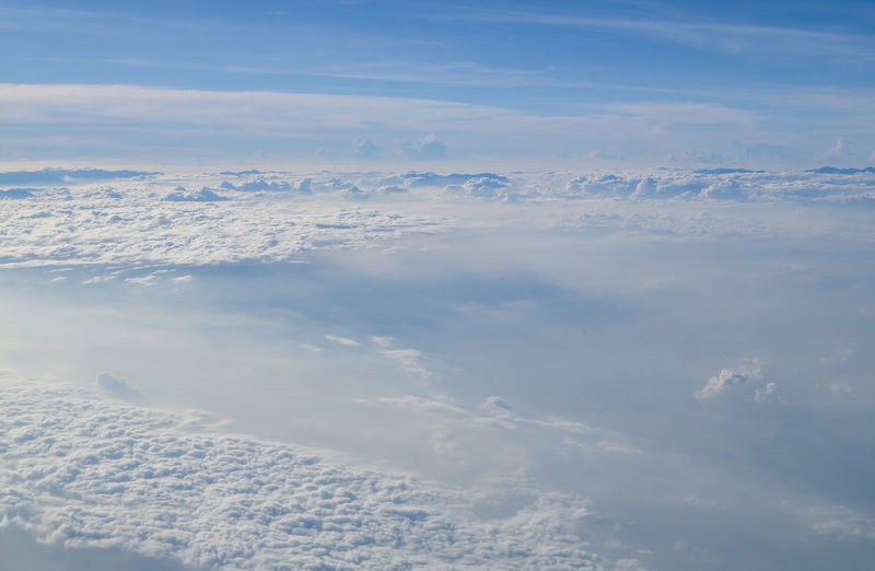 Cumulus cloudscape view from an airplane window on a sunny blue sky background. Cumulus Cloud Cloudscape View Airplane Window Frame Sunny Morning... Blue Sky Backgrounds Nature Aerial View Above