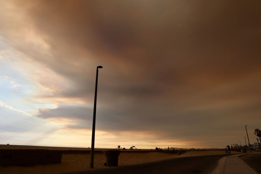 smoke from a california wildfire covering the sky over the beach in Huntington Beach california Huntington Beach CA Smoke California Wildfire City Cloud - Sky Dusk Land Light Nature Ominous Sky Outdoors Pollution Road Scenics - Nature Sky Smoke Filled Sky Street Street Light Tranquil Scene