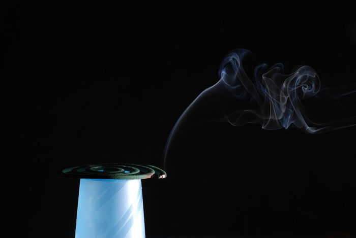smoke of mosquito repellant in a dark room Smoke Black Background Burning Close-up Copy Space Indoors  Mosquito Mosquito Repellant No People Repellent Smoke - Physical Structure Studio Shot First Eyeem Photo EyeEmNewHere Love Yourself