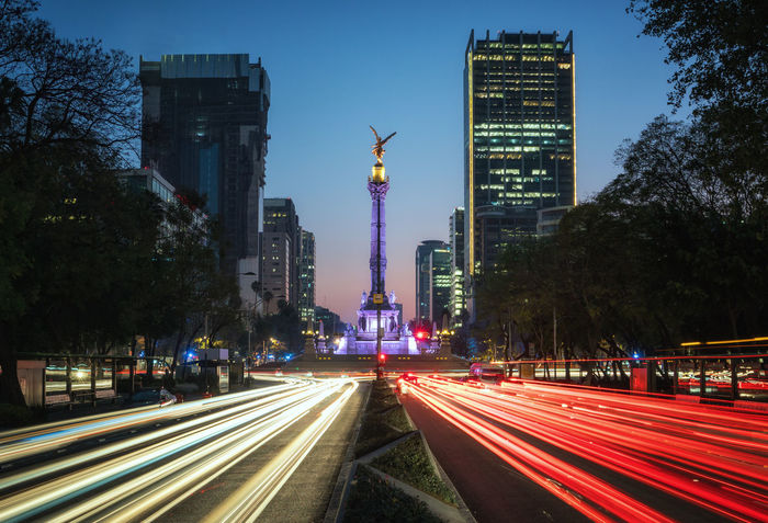 High speed traffic, Mexico City long exposure shot on Paseo de la Reforma with a view on Angel de la Independencia Angel De La Independencia Blue Hour El Ángel De La Independencia Mexico Morning Architecture Building Exterior City Dusk High Street Illuminated Light Trail Long Exposure Motion No People Outdoors Paseo De La Reforma Speed Transportation Travel Destinations Tree Mobility In Mega Cities This Is Latin America Capture Tomorrow