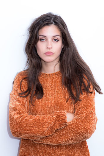 Looking At Camera Portrait Front View Studio Shot Young Women One Person White Background Young Adult Indoors  Waist Up Casual Clothing Brown Hair Sweater Hair Women Hairstyle Standing Beauty Beautiful Woman Teenager Warm Clothing Woman Portrait Portrait Of A Woman