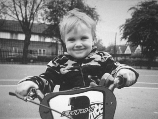 Fatherhood Moments Childhood Person Leisure Activity Focus On Foreground Elementary Age Front View Warm Clothing Lifestyles Enjoyment Playing Casual Clothing Holding Day Innocence Outdoors Summer Hello World Black And White Blackandwhite Blackandwhite Photography Cute First bike