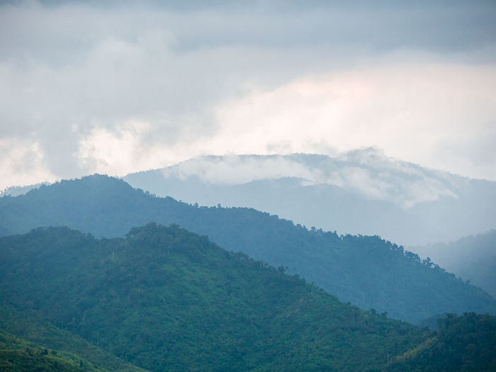 Beautiful nature of hills and mountains complex with morning mist atmosphere.