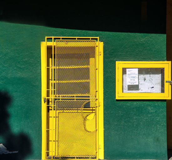 Close-up of yellow closed door of building