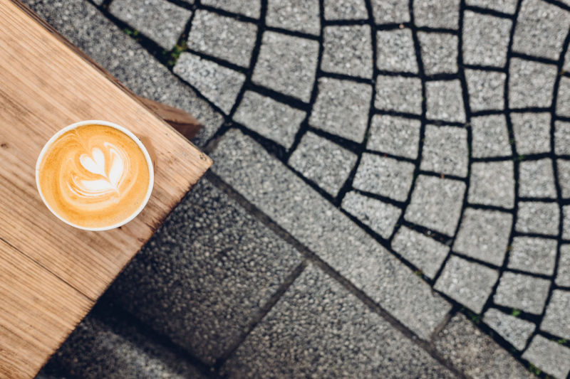 Cafe latte in a takeaway cup on a wooden bench Coffee Coffee Shop Coffee Time Coffee ☕ Japan Japan Photography Kamakura Kamakura Japan Latte Cafe Latte Coffe Coffee - Drink Coffee Break Coffee Cup Coffee Photography Coffeetime Concrete Late Latte Art Latte Photography Latteart negative space Take Away Coffee Takeaway Wooden Bench