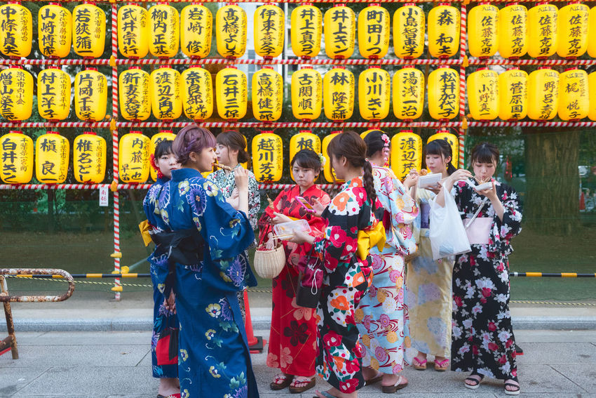 Group of Japanese girls wearing traditional kimono at Mitama Matsuri festival in summer at the shinto shrine Yasukuni Jinja in Tokyo. Japan Japanese Culture Lanterns Matsuri Mitama Matsuri Shinto Shrine Tokyo Traditional Clothing Yasukuni Shrine Clothing Females Festival Group Of People Japanese Girls Kimono Leisure Activity Lifestyles People Real People Shintoism Streetphotography Togetherness Traditional Clothing Women Yellow The Photojournalist - 2018 EyeEm Awards