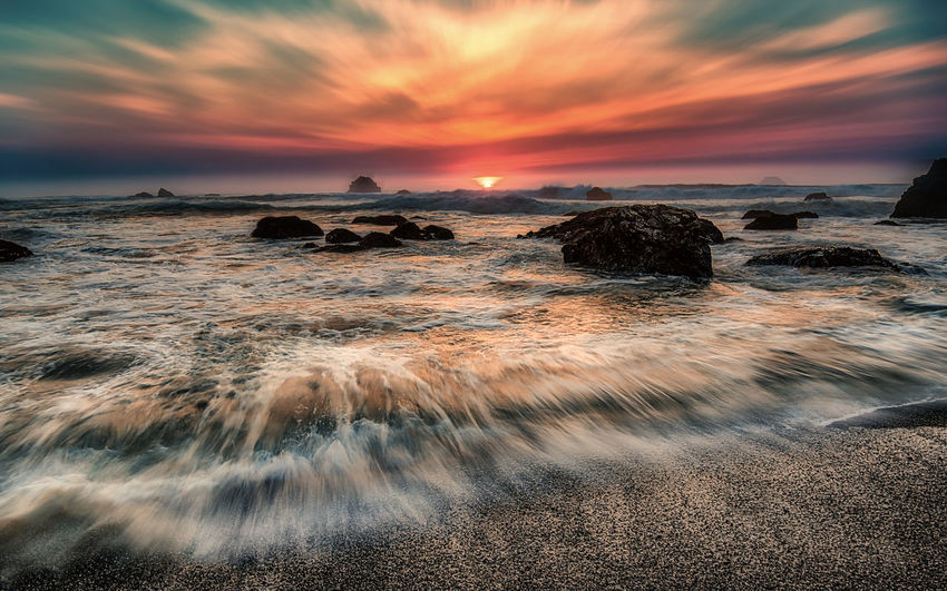 Sunset at the beach. Pacific Surf Wave Beach Beauty In Nature Blurred Motion Cloud - Sky Day Dramatic Sky Horizon Over Water Long Exposure Motion Nature No People Ocean Outdoors Rock - Object Scenics Sea Sky Sunset Tranquil Scene Tranquility Water Wave