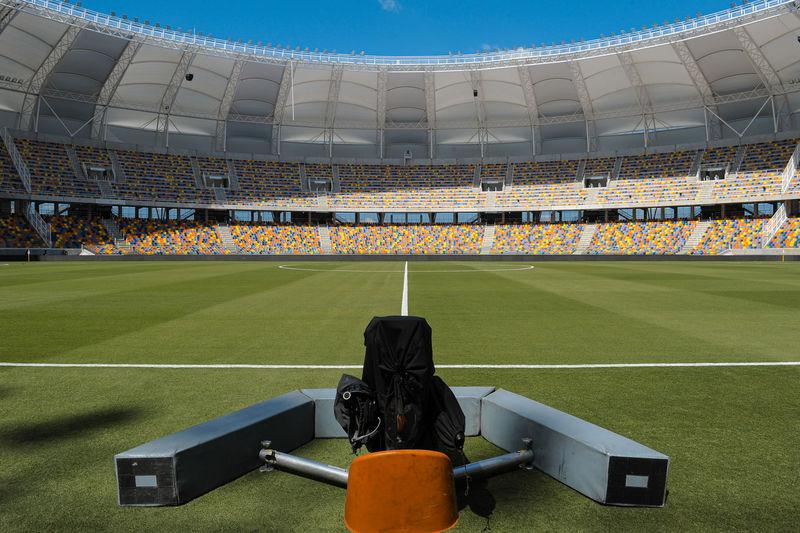 Empty soccer field and a transmition camera spot