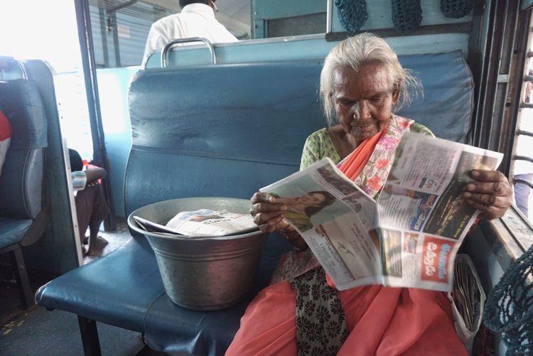 Senior Woman Holding A Newspaper