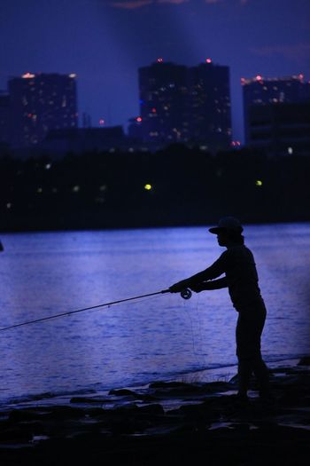 Buildings Japan Tokyo Real People Water Silhouette Night One Person Leisure Activity Standing Men Fishing Outdoors City Nature Lifestyles Sky Sea Illuminated Side View Holding Full Length Architecture