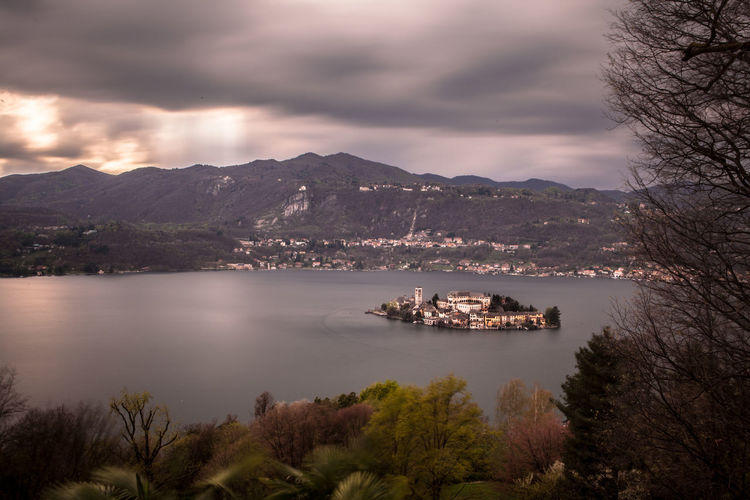High angle view of isola san giulio in lake orta against mountains