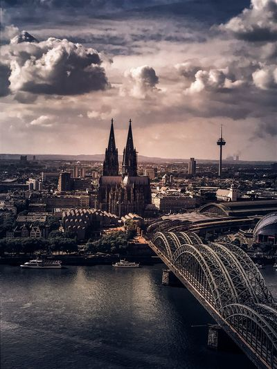 Cologne Architecture Building Exterior Cloud - Sky Sky Built Structure City Water Travel Destinations No People Cityscape Transportation Sunset Dusk Travel Nature River Spire  Building Tourism Outdoors