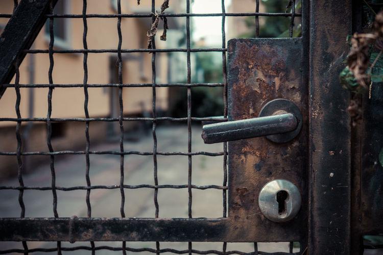 Close-up of metal gate handle