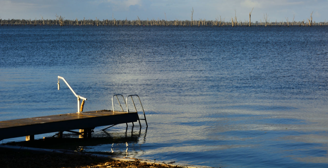 water, tranquility, beauty in nature, nature, no people, tranquil scene, scenics, outdoors, sea, day, diving platform, sky