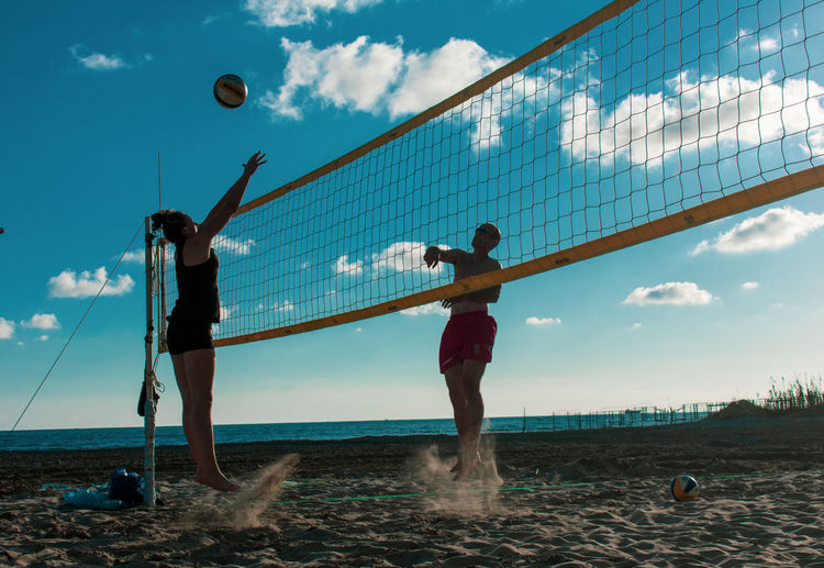 Jumping Playing Beach Volley Playing Games Volleyball - Sport Beach Volleyball Field Beach Volleyball Net Playing Outside Water Beach Sportsman Full Length Men Business Sky Beach Volleyball Shore Volleyball - Sport Net - Sports Equipment