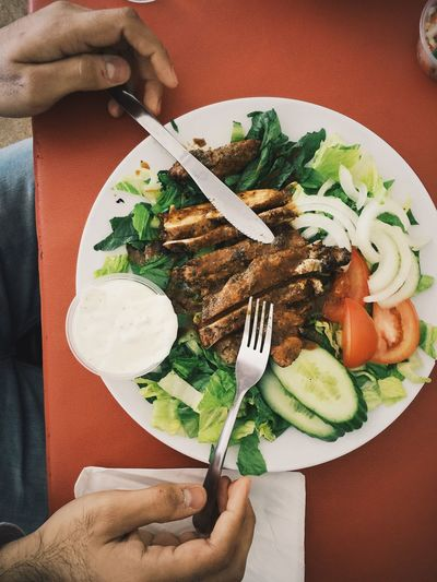 Cropped Image Of Man Having Meat And Salad