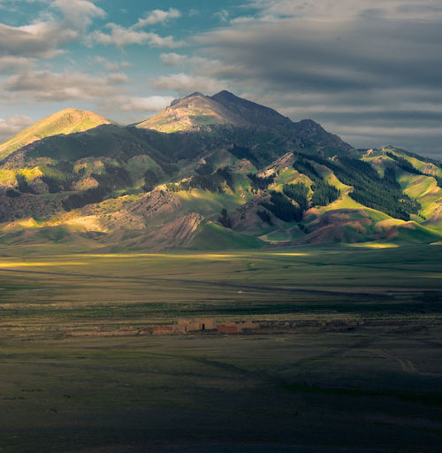 赛里木湖畔日出 Scenics - Nature Cloud - Sky Landscape Beauty In Nature Mountain Green Color Outdoors Day No People Sky Sunlight Sunlight And Shadow Field