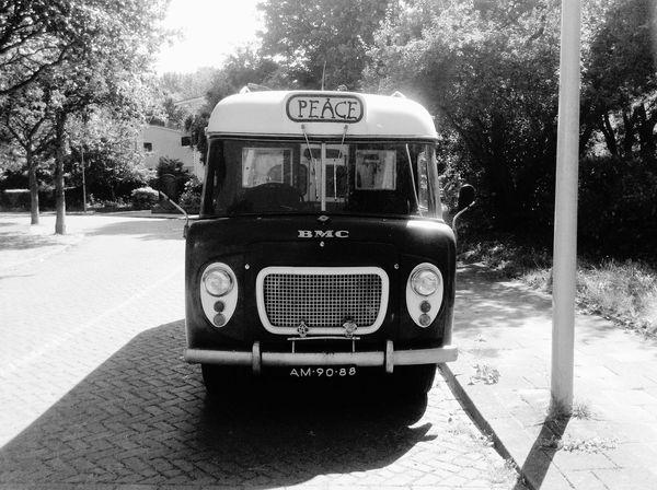Peace Carspotting Denhaag To Go Den Haag Bmc Old Bus Oldtimer Peace Black & White Oldschool Hippie Bus Hippie Made In Great Britain Netherlands Holland Car Text No People Outdoors Mode Of Transportation Retro Styled Street Bus Land Vehicle