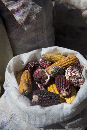 High Angle View Of Corns In Sack For Sale At Farmer Market