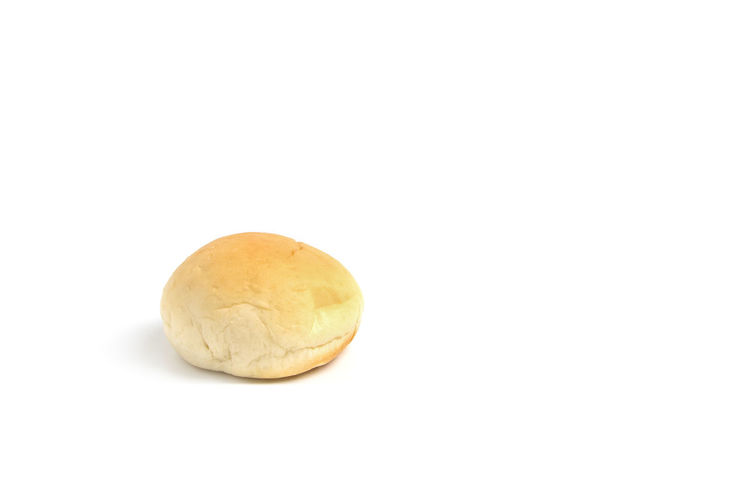Close-Up Of Bun Against White Background