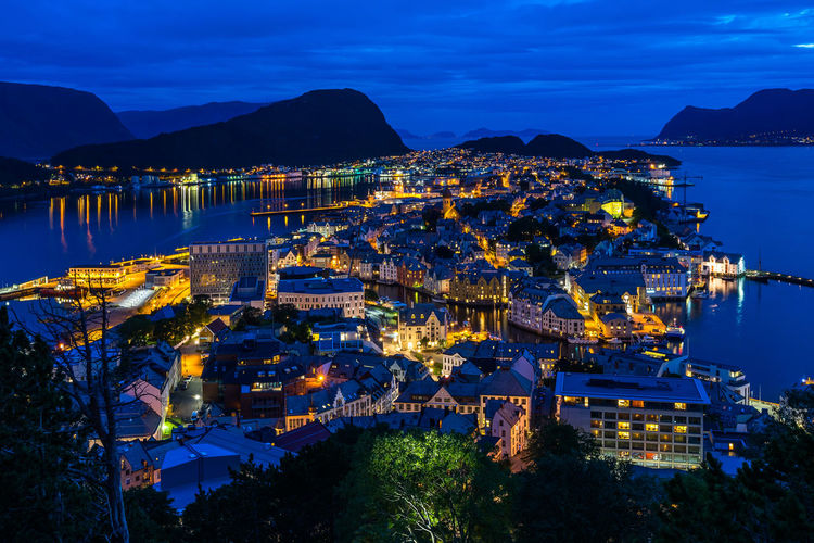 Scenic night cityscape of Alesund viewed from Aksla hill, More og Romsdal, Norway Norway Norge Norwegian Scandinavia Northern Europe Ålesund, Norway Alesund Art Nouveau Blue Hour Water Architecture Building Exterior Mountain Built Structure City Sea Sky Building Illuminated Nature Residential District No People Dusk Cloud - Sky Mountain Range Beauty In Nature Scenics - Nature High Angle View Cityscape Outdoors Bay TOWNSCAPE