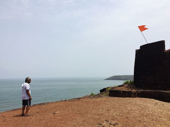 Back to the roots Man Monument Flag Fort Travel Destinations Travel Malvan Konkan Kokan Devgad Mobilephotography EyeEmNewHere Water Real People Sky Land Sea Beach One Person Outdoors Rear View Day Full Length Horizon Over Water Horizon EyeEmNewHere A New Beginning