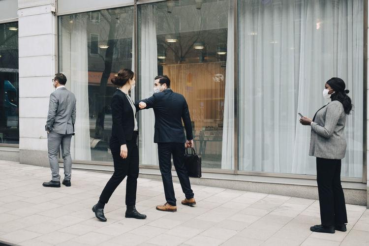 Group of people walking in office building