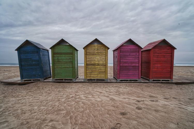 Beach hut against sky