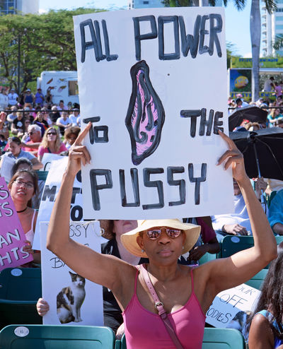 Women Around The World Womensmarch Women's March Women Togetherness Public Places Protest Signs Politics And Government Protesting International Women's Day Community Miami Florida January 21, 2017 women's rally at Bayfront Amphitheatre in downtown Miami