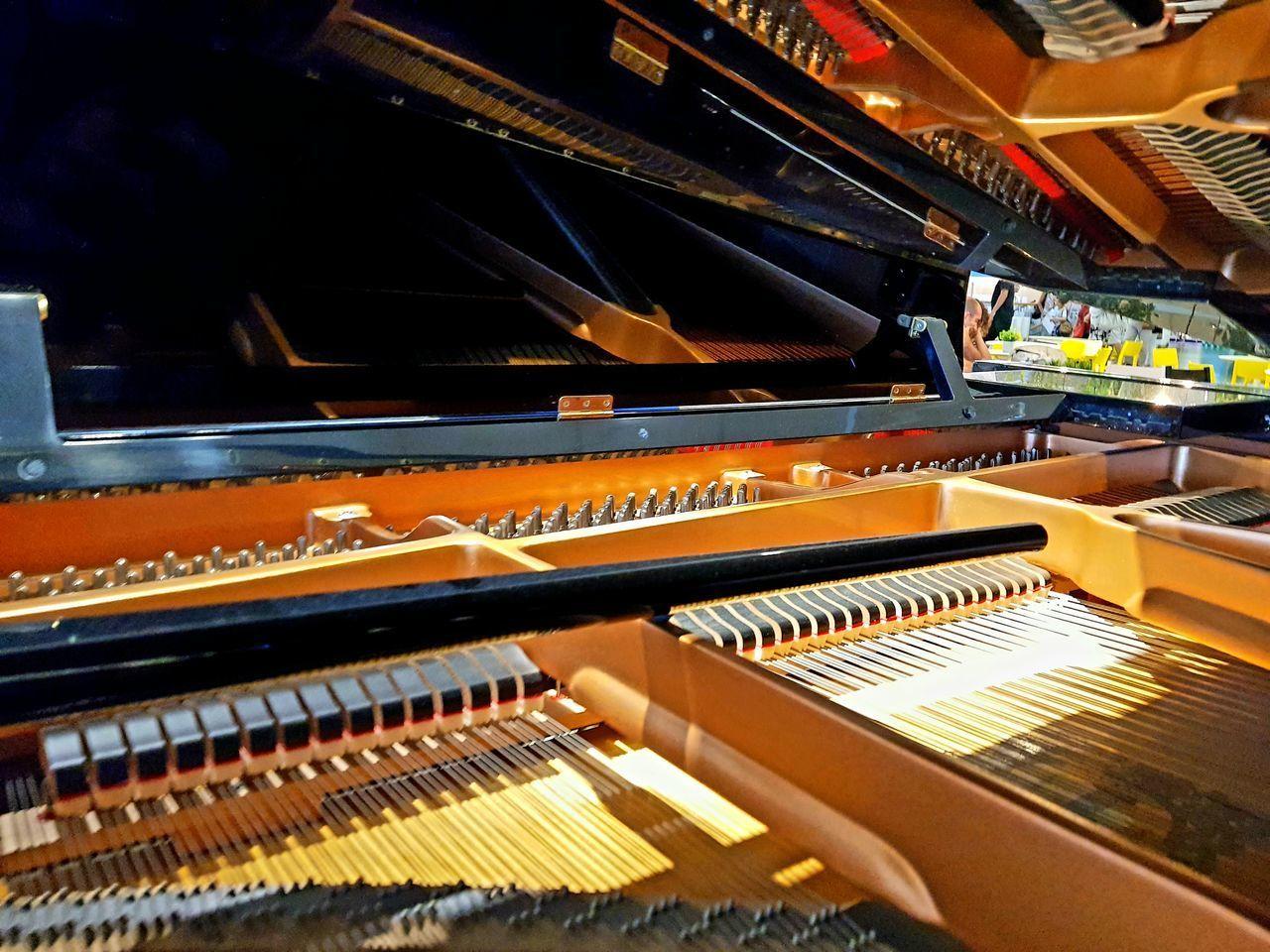 HIGH ANGLE VIEW OF PIANO KEYS AT NIGHTCLUB