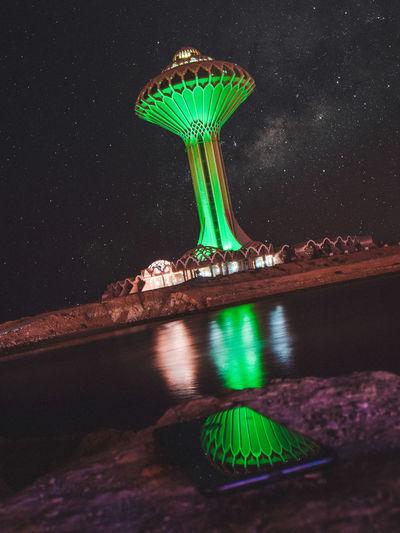 Illuminated sculpture at night