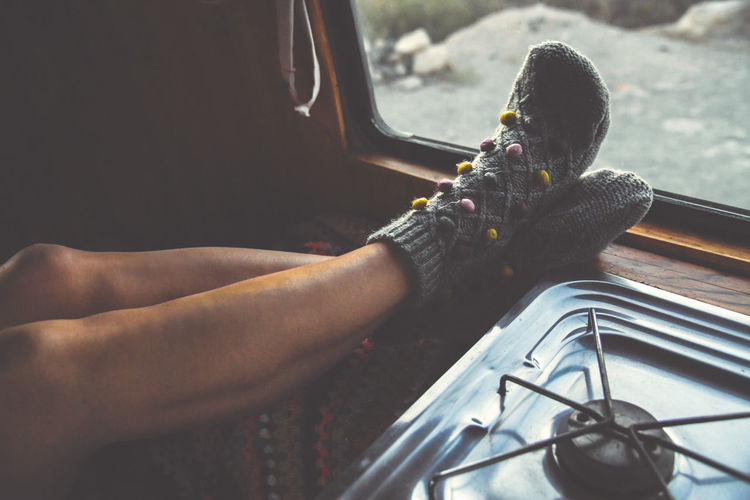 Woman feet in warm socks on vintage van. Mountain summer trip. Nomad life, girl legs in cute knitting sock near the window. Freedom travel concept. Autumn weekend. Female leg in an old wooden camper Human Hand Human Body Part Hand One Person Real People Transportation Mode Of Transportation Men Day Lifestyles Leisure Activity Land Vehicle Body Part Sitting Nature Holding Car Travel Outdoors