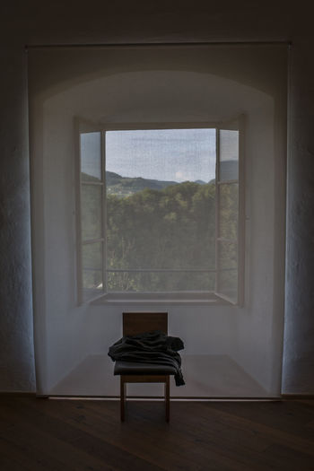 Absence Architecture Chair Day Empty Flooring Frame Glass - Material Home Interior Indoors  Nature No People Plant Seat Transparent Tree Window Window View Windowframe Wood Wood - Material