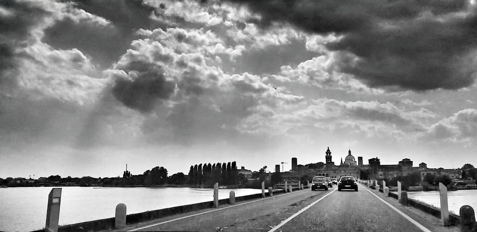 Mantova Cloud - Sky Travel Destinations Travel Landscape Outdoors Storm Cloud Day Sky City Blackandwhite Italy Photo Photography Zhoxha Photooftheday Photographer Follow City Architecture Clouds Dramatic Sky World Water River Mantova